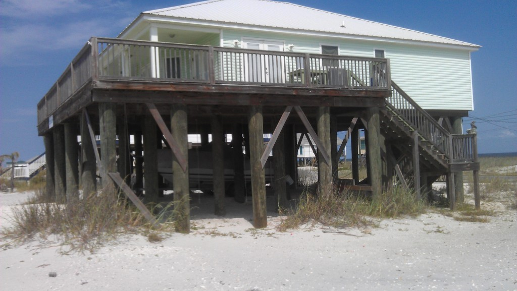 "One of our beach houses on ""stout"" (18"" diameter) piles"